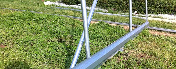 Metal baseboards for high tunnels